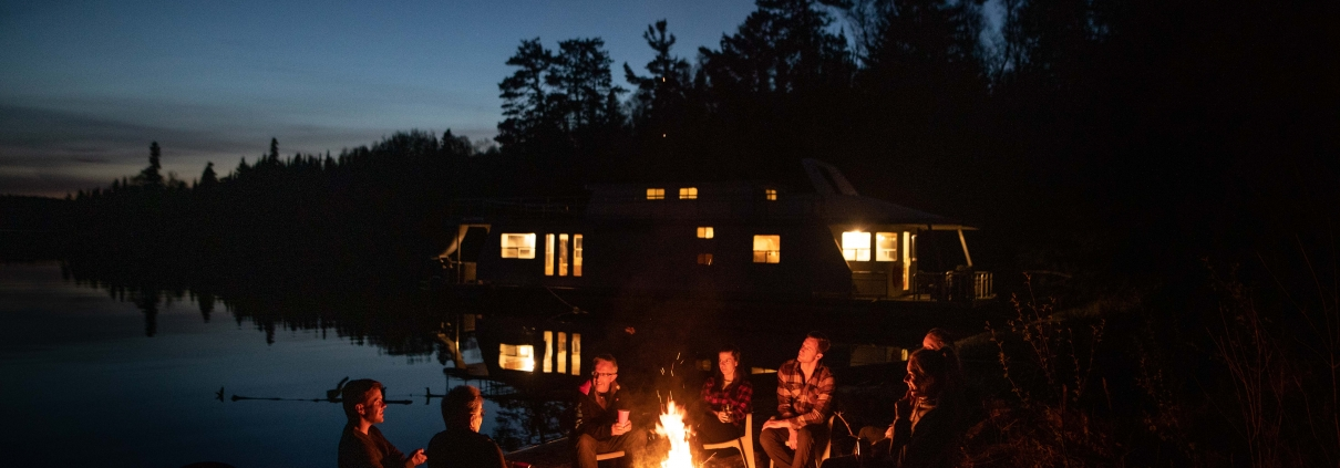 Relax at the end of a fun-filled day on your houseboat trip with a beach campfire.
