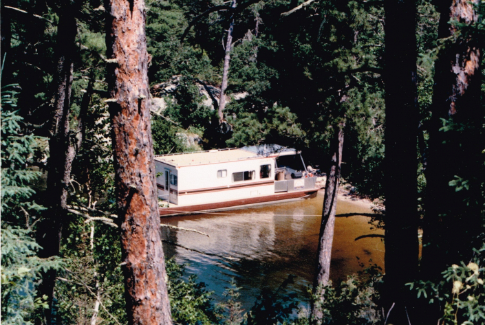 40 foot Houseboat Adventures houseboat named Bravo on Lake of the Woods 1985