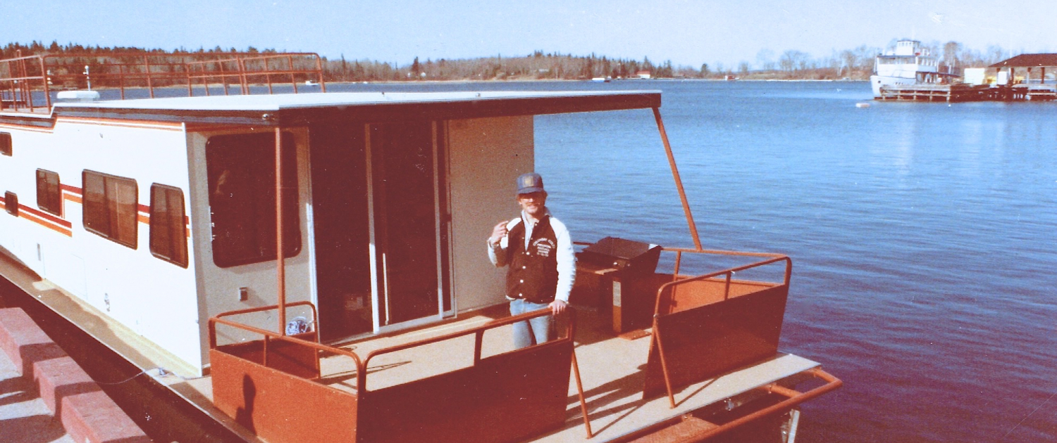 Jeff launches our first houseboat on Lake of the Woods May 1983