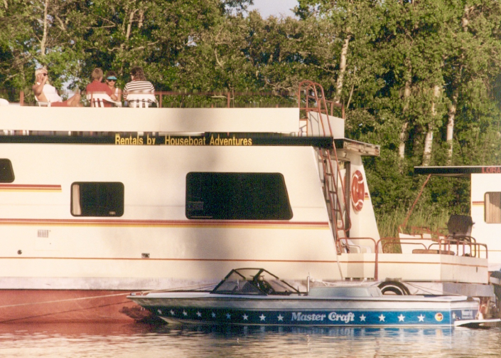 Guests enjoy the upper deck of 46-foot houseboat. Rentals by Houseboat Adventures o Lake of the woods Kenora Ontario.